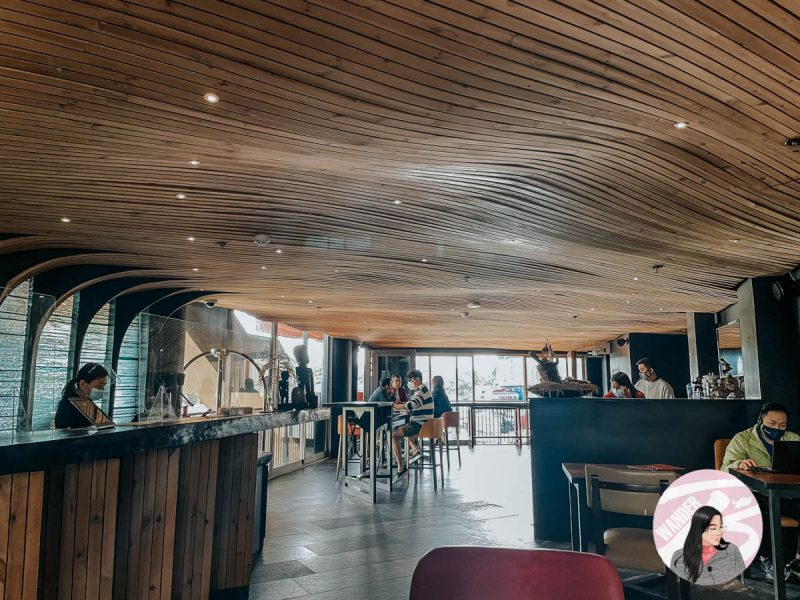 the reception of g1 lodge hotel with wooden ceiling