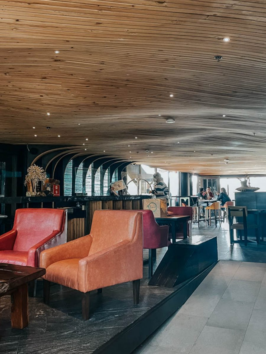 chair and the reception under the wooden ceiling of g1 lodge design hotel in baguio